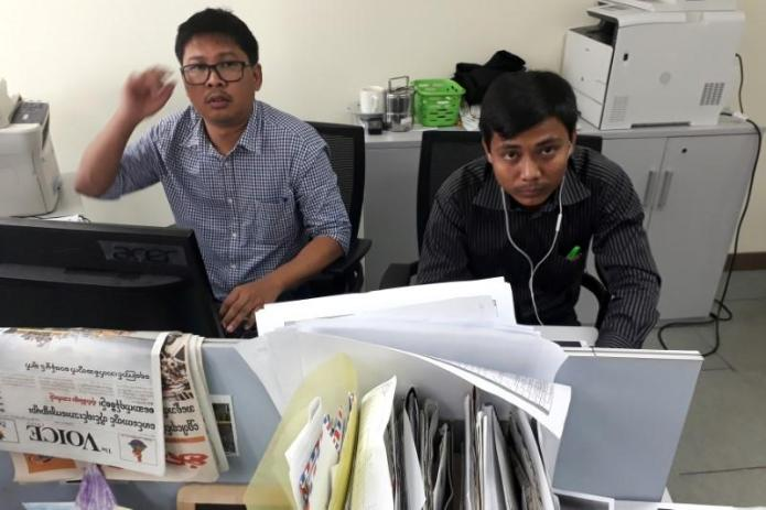 Reuters journalists Wa Lone and Kyaw Soe Oo pose for a picture at the Reuters office in Yangon, Myanmar